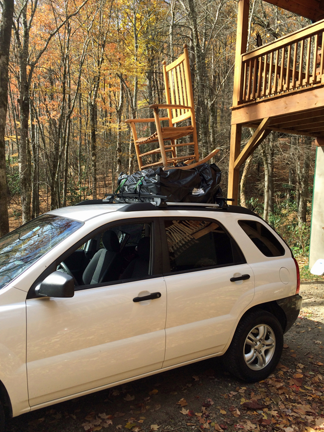 Car with Rocking Chair on top