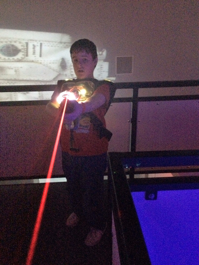 Mikey, firing a laser rifle at Granddad. We had a lot of fun playing laser tag, but I have to remember I'm too old to do a rolling somersault anymore.