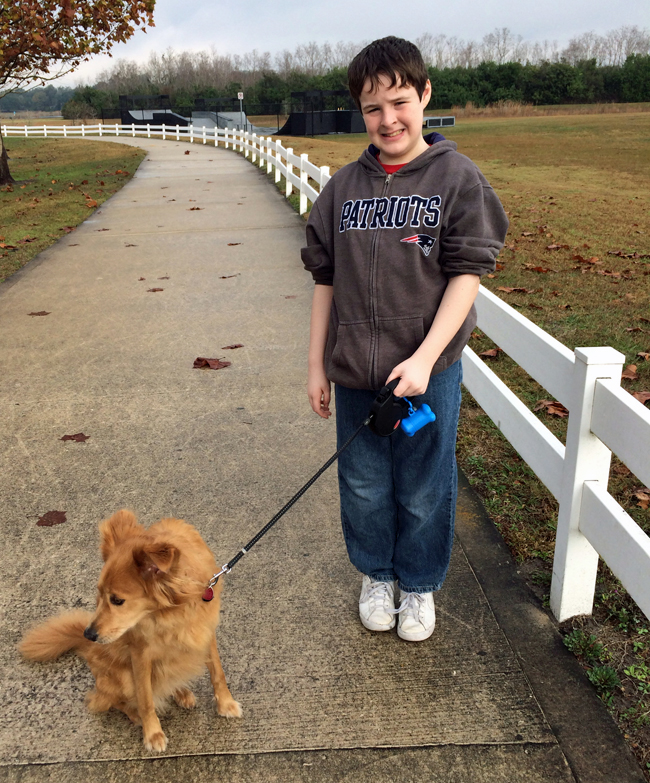 Mikey and Bella on the walkway to the dog park.