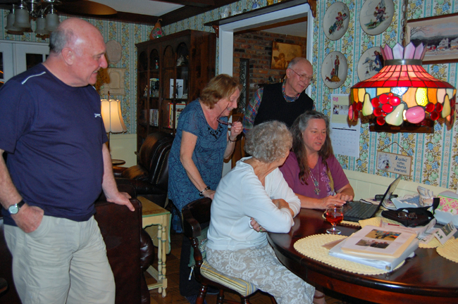 family looking at photos online