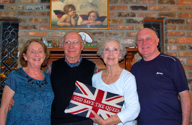 """Family with """"God Save the Queen"""" pillow"""