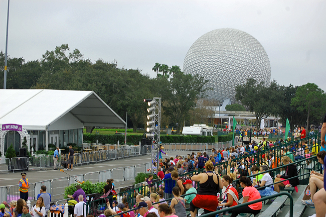 Crowd shot with EPCOT's Spaceship Earth in the background.