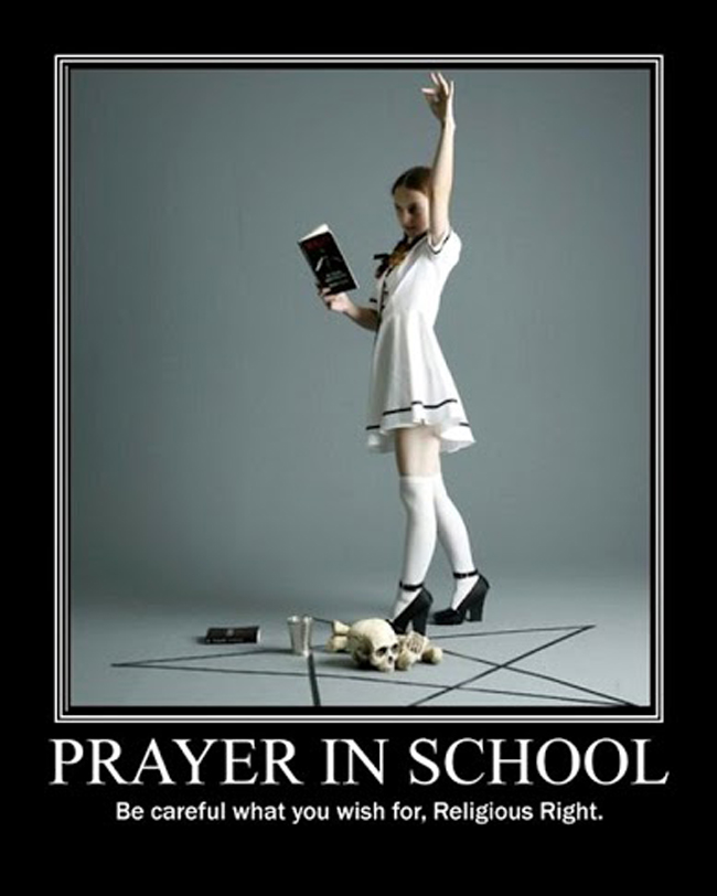 Young schoolgirl performing satanic prayer