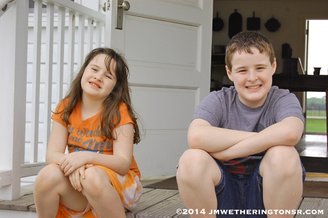 Close-up of Mikey and Heather on lunchroom steps.