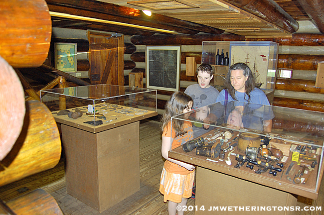 Grandma, Mikey and Heather examining some of the artifacts of life in the fort almost 200 years ago.