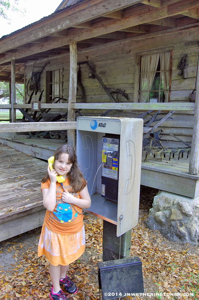 This was a strange anomaly. A pay phone right outside an old cracker cabin. Heather tries to call the past to let them know she's visiting.