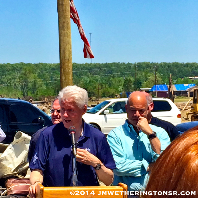 Former President Clinton speaking to reporters. Afterward he would graciously pose for photos with townspeople who were affected by the tornado.
