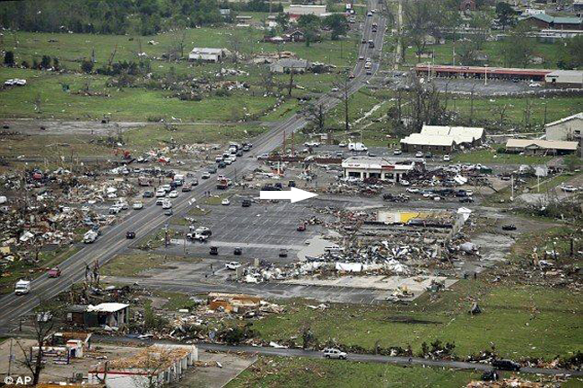 An aerial view of the devastation in Vilonia, AR. The white arrow indicates where the FEMA MRIC was parked and where the press conference took place.