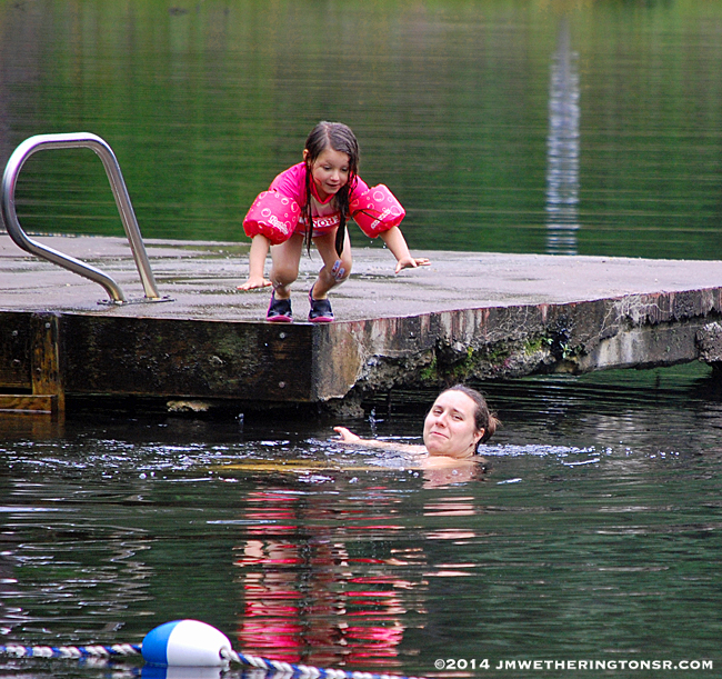 I didn't get the shot of Abby landing in the water on the previous jump, so she did it again for granddad. Unfortunately, mommy wasn't looking at her when she jumped.