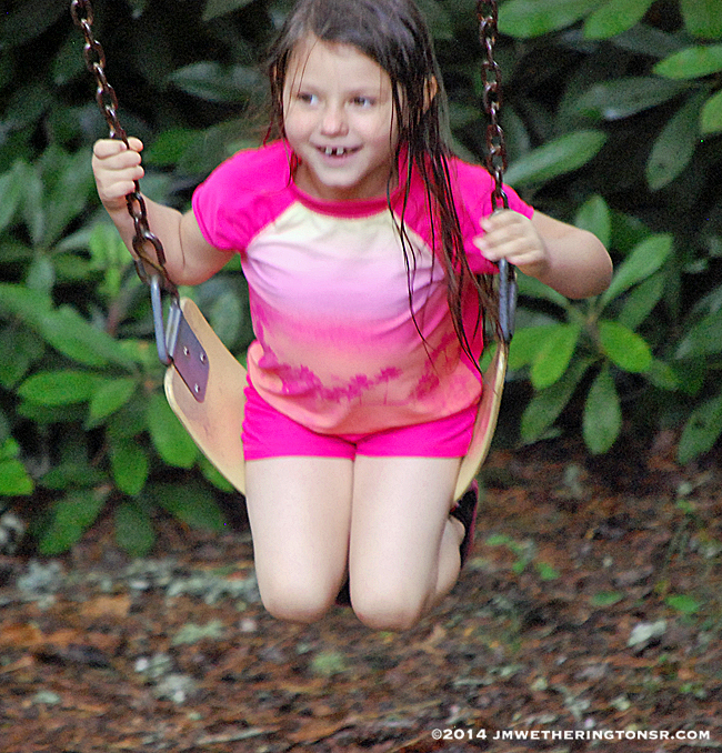 After the swim, Abby had fun on the nearby swings.