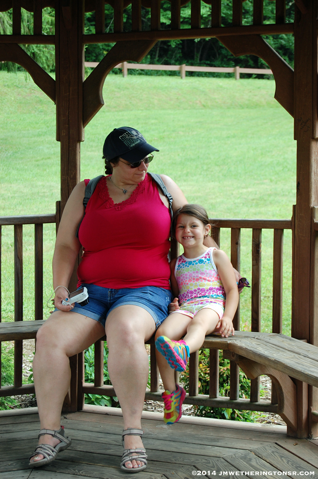 Amber and Abby relax in a gazebo on the lake's shore.