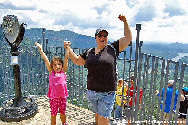 Abby and Amber celebrating their ascension to the top of Chimney Rock!