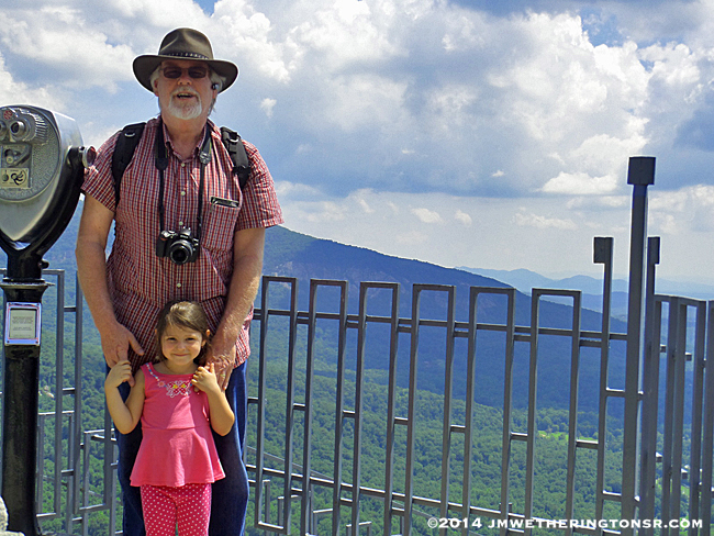 Granddad and Abby standing at the top of Chimney Rock.