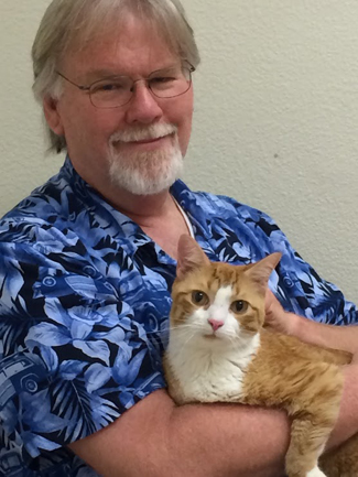 One of the sobering parts of my birthday; Cindy took this photo of Tigger and yours truly before we had to leave him for an overnight stay at the vet's office. His diabetes has returned and he was dehydrated. Hoping for better news tomorrow.