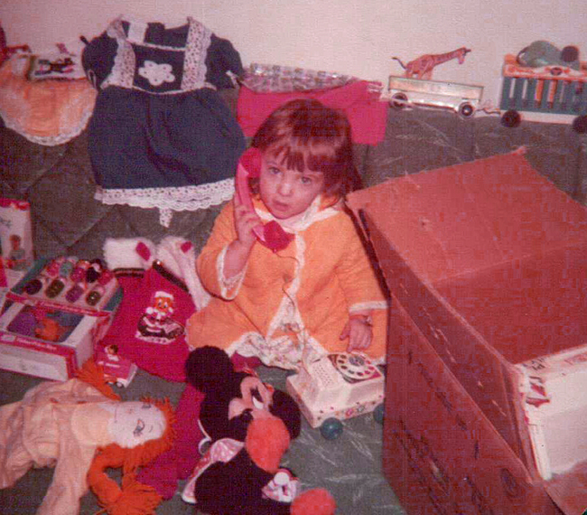 Ann with Christmas presents 1977