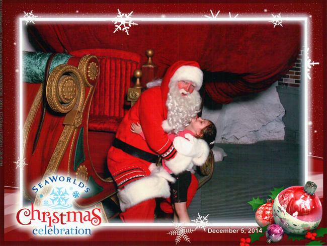 Abby trying to kiss Santa Claus at Sea World Orlando