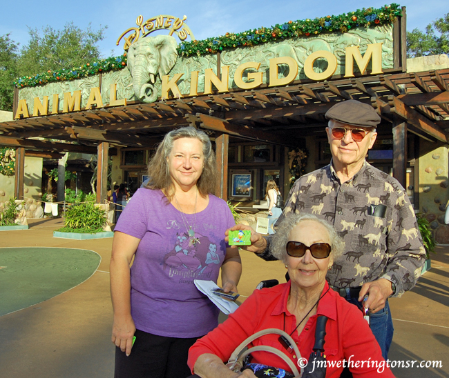 Cindy, her mom and dad at the entrance to Disney Animal Kingdom