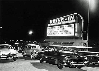 Drive-in Theater sign and cars