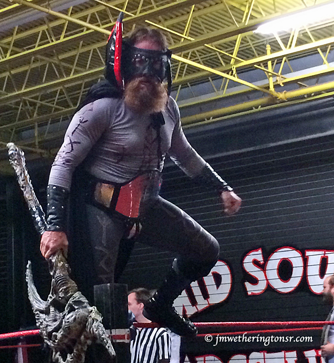 "This guy won the ""Best Costume Award"", at least in MY book. But he made a laughing stock out of himself when (remember that unwrapped ring rope I told you to make note of?) he tried to make a flip-off-the-rope entrance, slipped, and landed mask first (yes, he wore the mask throughout the match) in on the mat with the crowd simultaneously gasping (because it looked like he had broken his neck) and laughing (when they realized he hadn't). They really should fix that rope."