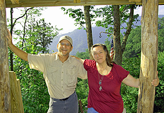 Art Littlefield and Cindy at the door to his cabin in Maggie Valley.