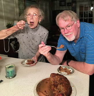My mother-in-law and I enjoy the delicious fruitcake my sister-in-law Pia made.