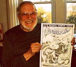 John Romita, Sr. holding up an Amazing Spider-Man comic book cover drawing