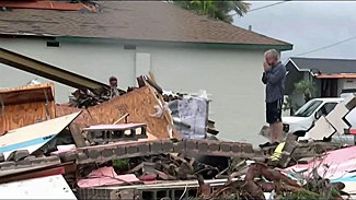 Homeowner surveys home destroyed by Hurricane Harvey in this photo from NBC News