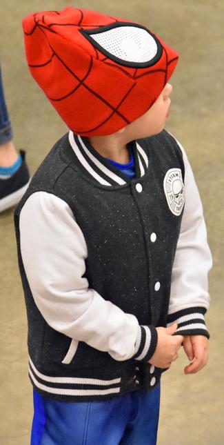 Little boy in Spider-man mask