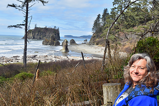 Cindy looking at drift logs and seat stacks on Ruby Beach.
