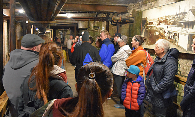 Tour group at the first stop of the Underground Seattle tour.