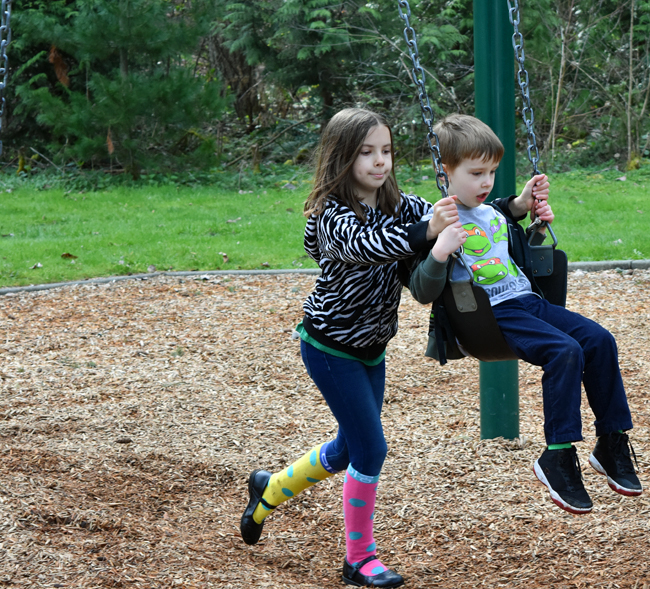 Jade pushing Maxwell on a swing at http://www.redmond.gov/ParksRecreation/Farrel-McWhirterFarmPark