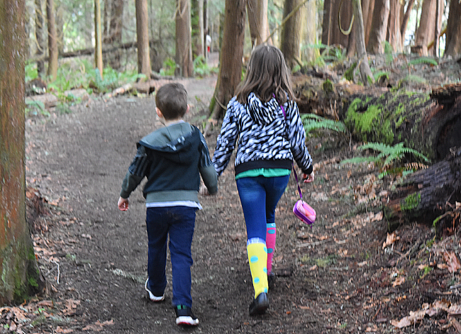 Jade and Maxwell holding hands while walking on the nature trail at http://www.redmond.gov/ParksRecreation/Farrel-McWhirterFarmPark